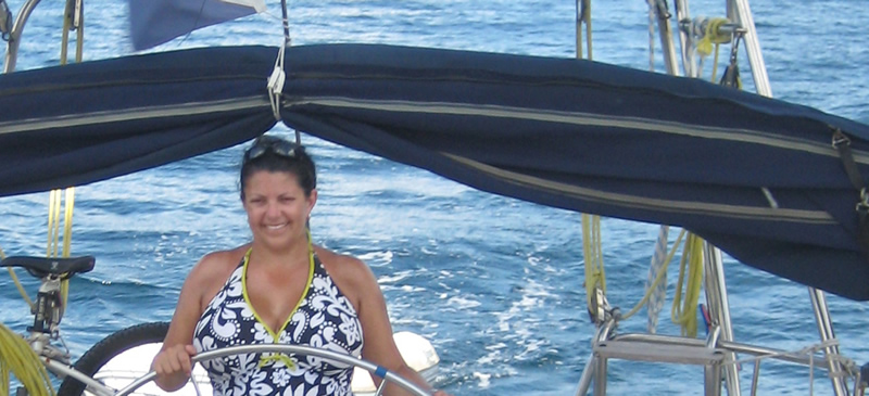 Lee Stacey at the helm of Yacht Ibis on the Caribbean